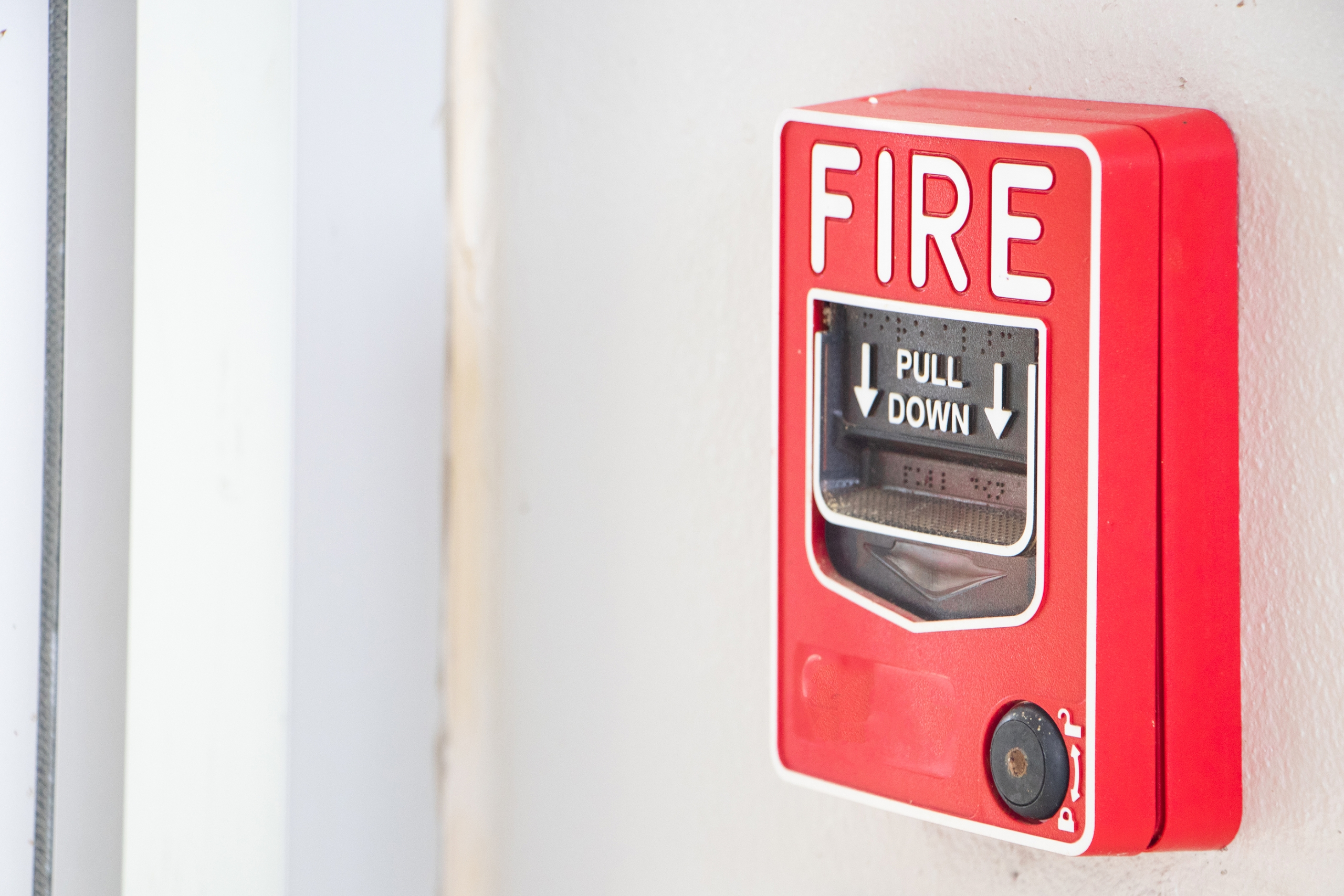 red-fire-alarm-system-on-wall-scaled